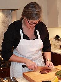personal chef slicing lamb